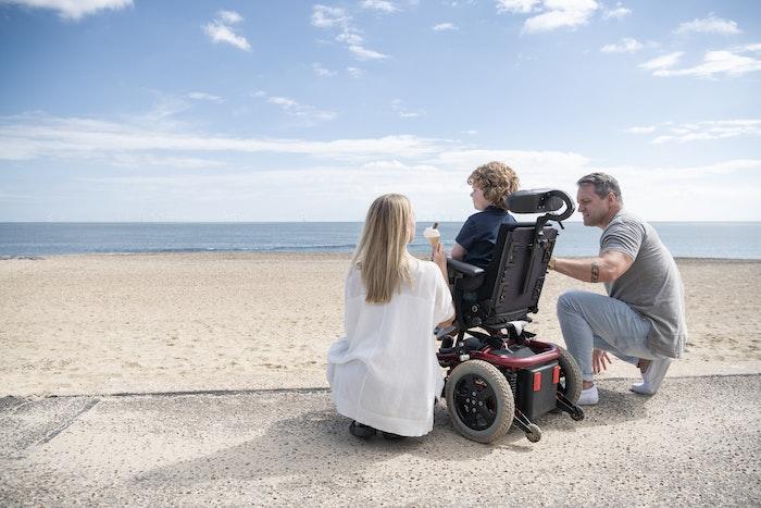 boy-with-parents-at-beach-jpg