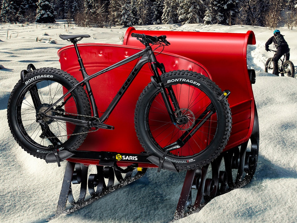 Bike on back of sled in a snowy field