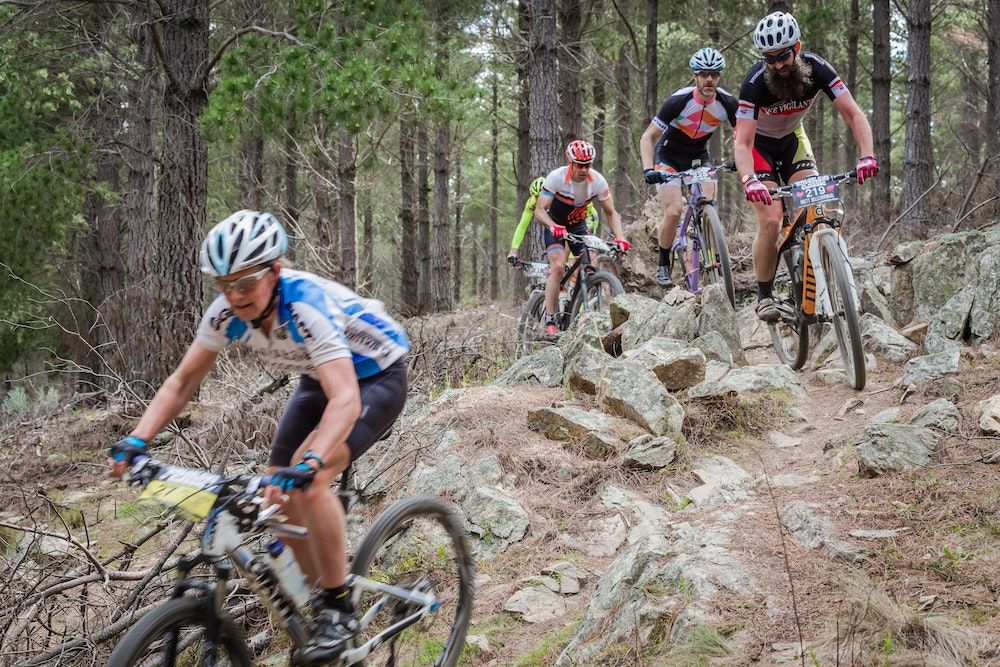 group of riders single track