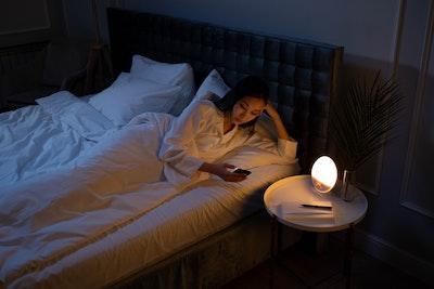 woman-in-bed-on-phone-jpg