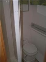 Golf separate shower and toilet. Dressing space  opposite