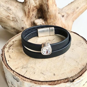 Reindeer leather double wrap bracelet with a Swarovski crystal and a magnetic clasp.