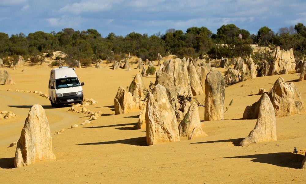 campervan-hiring-guide-shutterstock-sand-rocks-beach-off-road-jpg