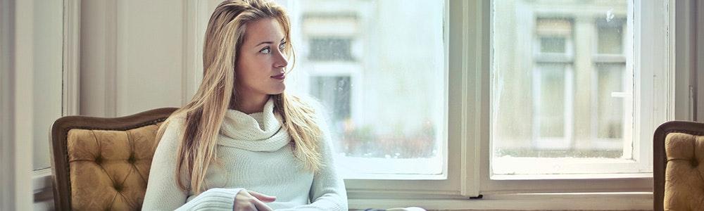 woman-sitting-next-to-window-jpg
