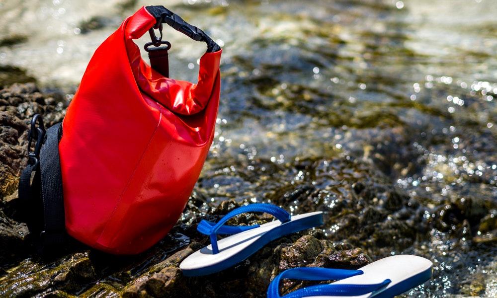 outdoria-six-camping-essentials-blog-list-dry-bag-thongs-flip-flops-rocks-river-jpg