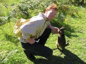 Shayne Neal from The Cape Otway Centre for Conservation Ecology with a wallaby friend called Forest.