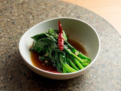 Stir fried Asian greens with garlic and sweet mushroom soy