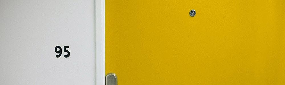 door-viewer-on-apartment-door-with-number-95-on-wall