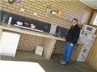 Trevor Liddell of Holbrook  Motor Village in the  parks enclosed camp kitchen