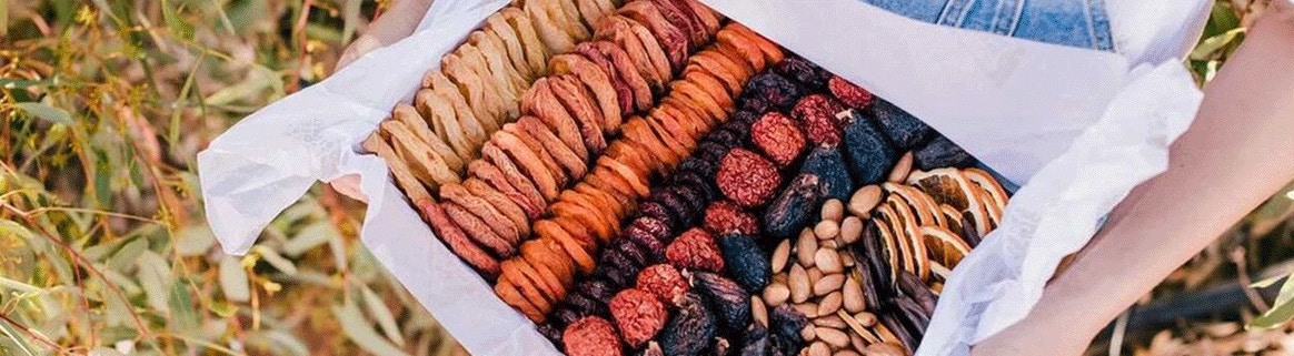 a hamper of dried apricots, pears, figs, almonds and dried citrus