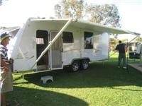 Green  grass site  Setting-up GoSee Sterling awning at Junee Tourist Park