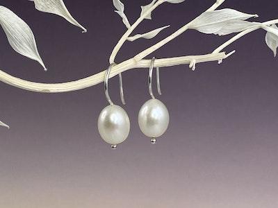 Large single white pearl hook earrings