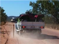 A 4wd dives off the bitumen to make way for large truck