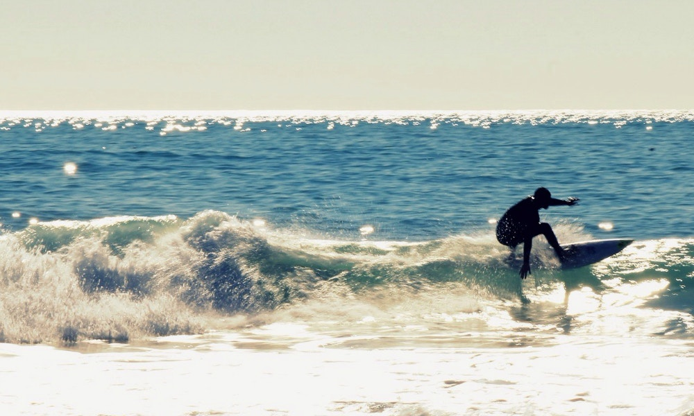 7 Steps to Standing Up on a Surfboard
