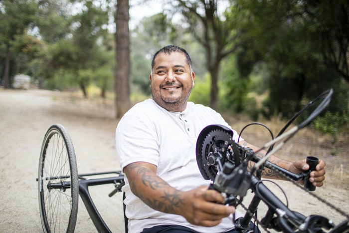 a-man-riding-a-hand-cycle-bike-jpg-jpg