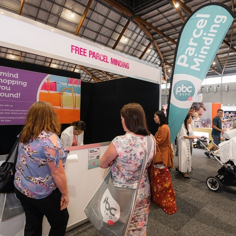 Image of two women dropping their shopping with text underneath that reads Parcel Minding Our FREE Parcel Minding Service means you can make the most of all the great offers and still wander the Expo without carrying it all with you.