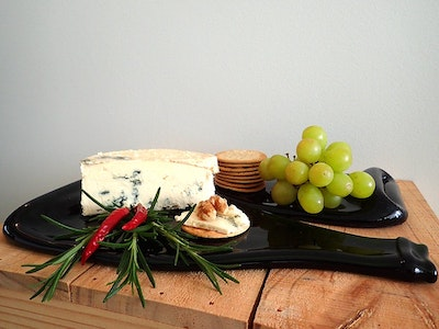 Upcycled champagne bottle cheese board