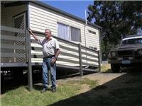 Kevin Downie of Lake Hume Tourist Park with one of six new Jayco cabins