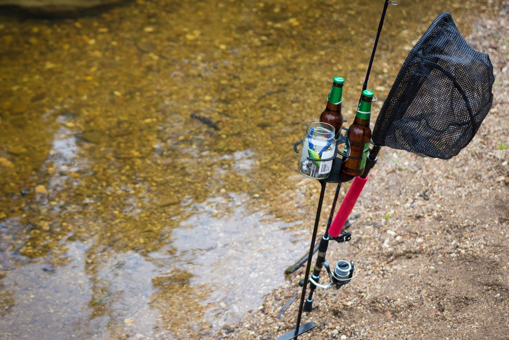 Aussie outdoor mates drink mate being used as a fishing rod holder