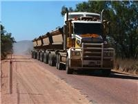 Queenslands narrow Gregory Highway challenges caravans, motorhomes and RVs to work with big rig truck drivers