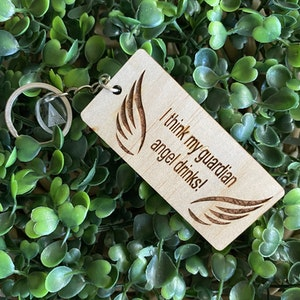 """""""I think my guardian angel drinks!"""" Quirky Timber Keyring - Laser Cut & Etched on Timber with Silvertone Hardware finished with a LLL Logo Tag."""