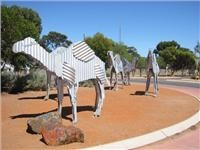Norsemans galvanised camels on the towns main roundabout WA