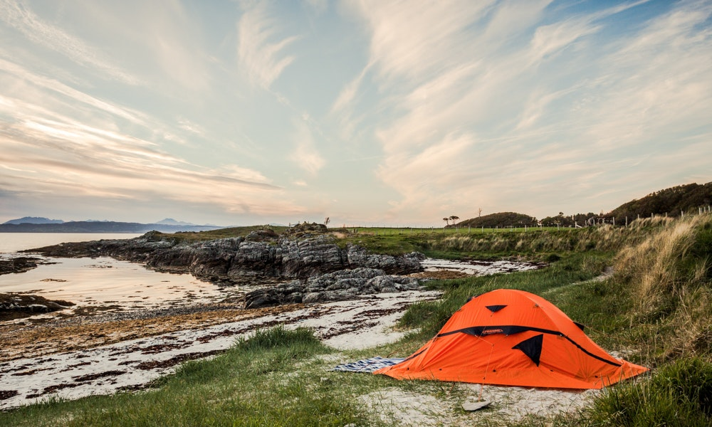 13-tips-summer-camping-guide-orange-tent-sunsent-beach-shore-jpg