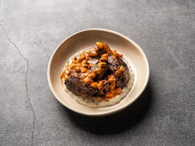 Slow roasted lamb shoulder, roasted eggplant, tahini & herbs, capsicum burnt butter (serves 2)