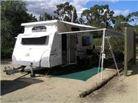 Seven Mile Beach Tasmania jayco Discovery with guys on awning 039