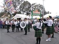 The Pipers draw a crowd to their street performance