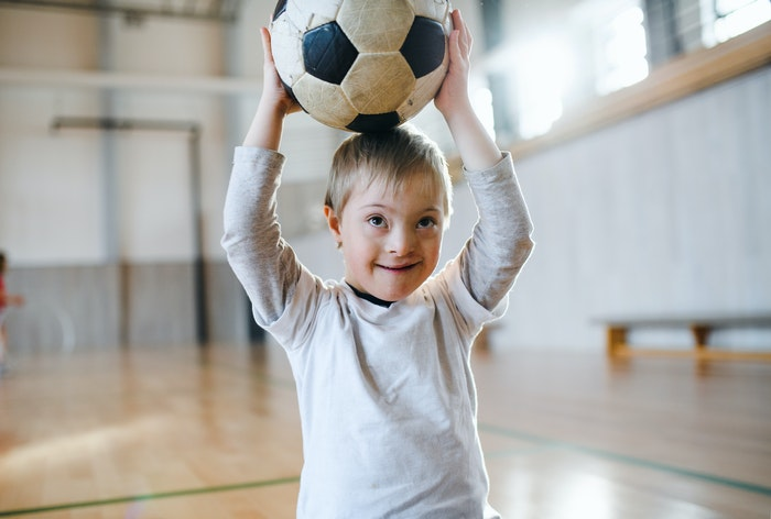young-boy-holding-soccer-ball-jpg