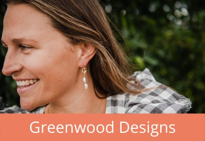 Woman with Greenwood Designs earrings