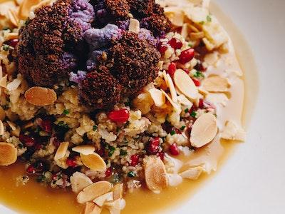 "Cauliflower ""Couscous"" with Dukkah Roasted Cauliflower, Pomegranate, Almond, Tahini"