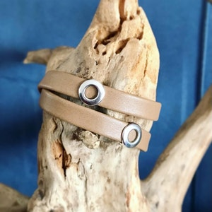 Reindeer leather double wrap bracelet with 2 silver circles and a magnetic clasp.