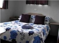 Big comfortable bed Gundagai Cabins and Tourist Park.