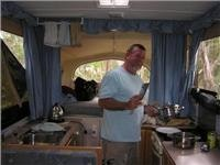 Master chef Morrison stirs up a meal in a Jayco Dove camper