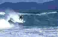 In the tube surfing Ninety Mile Beach courtesy imagesofgippsland