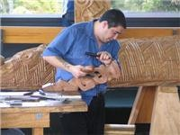 A Te Puia wood carving student. GoSeeNZ pic