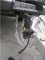 2. Safety chains and shackles connected.