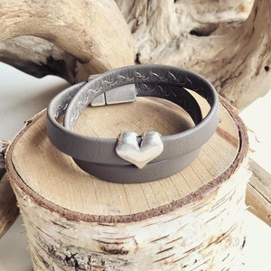 Reindeer leather double wrap bracelet with a silver heart slider and a magnetic clasp.