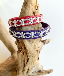Sami braided leather bracelet with sterling silver beads and magnetic clasp.