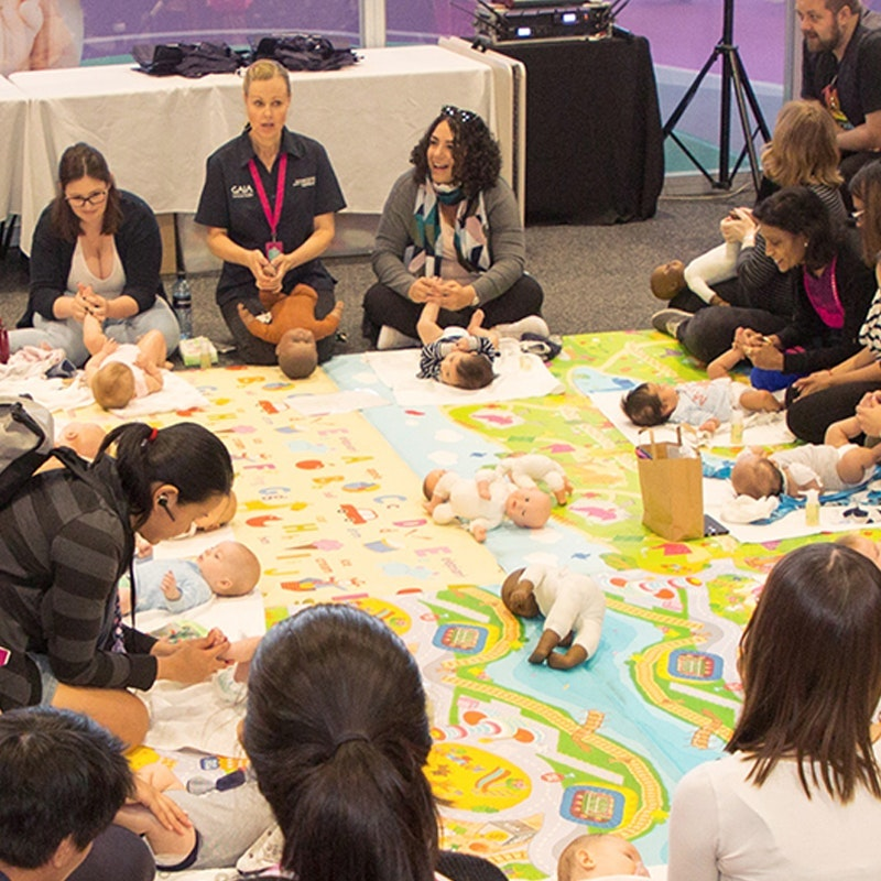 Image of visitors attending a baby massage workshops with text underneath that reads, Expert tips and advice. Up to date info plus free talks and interactive workshops