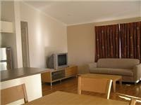 Comfortable lounge and TV area One Mile Beach Holiday Park