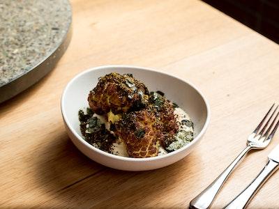 Turmeric cauliflower with sesame tofu dressing and Furikake