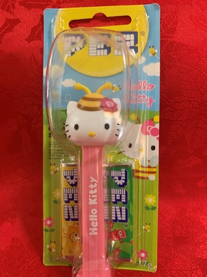 """Hello Kitty Bee Collection Pez Dispenser Mint on Card with """"Hello Kitty"""" on the stem"""