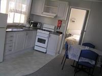 Kitchen and dining area Standard ensuite cabin  Park Lane Traralgon