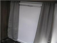 Jayco Silverline window with  shade up  Curtains are cosmetic