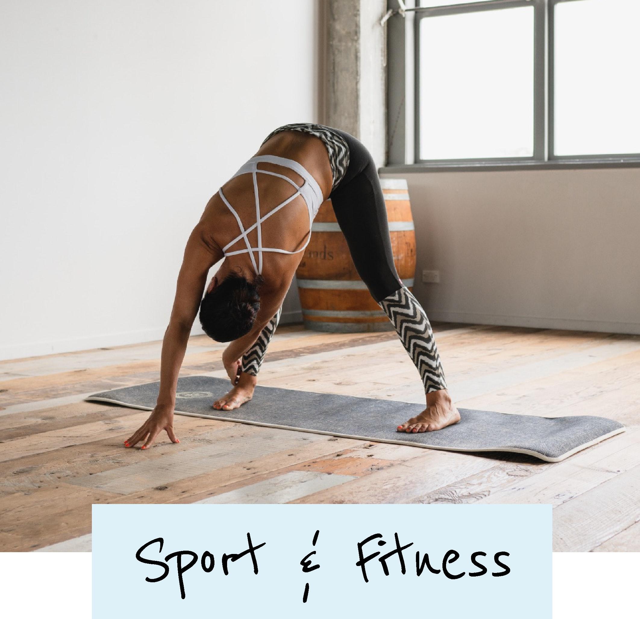 female doing yoga stretches