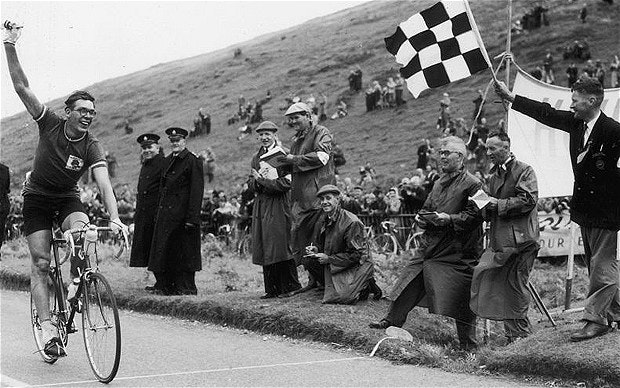 Booty takes the chequered flag to win the 120mile road race during the Empire Games in Cardiff in July 1958 Photo KEYSTONE GETTY