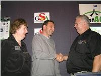 Graham Wallace and Agnes Hellwig congratulate Antony Klooger on winning the GoSeeAustralia Advertising Package